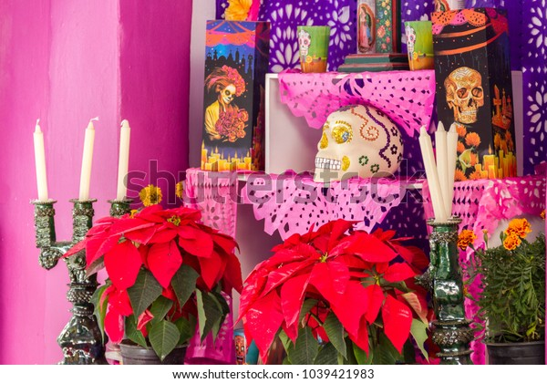 Morelia, Michoacan / Mexico - November 2 2016: Altar for whom have passed away. These are public adorns and altars used to honor the dead during all saints day in Mexico, a traditional holy day.