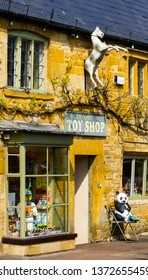 Moreton in Marsh, Gloucestershire. England- April 17, 2019: The Toy Shop, has been run by the same family for about 50 years. The façade has a dapple grey rocking horse over the door. High Street.