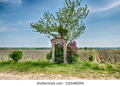 MOREY ST. DENIS, FRANCE - APRIL 22, 2018: An old stone gate marks the location of the premier cru Clos des Ormes vineyard near the town of Morey St. Denis in the Burgundy region of France.