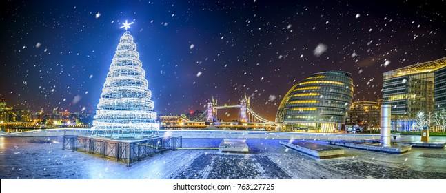 Morgan's lane panorama with Christmas tree and falling snow,London,UK