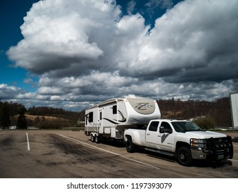 Morgantown, West Virginia / USA - March 25 2017: RV (Recreational Vehicle) Fifth Wheel Trailer with Truck Parked at Truck Stop Off Highway