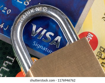 MORGANTOWN, WV - 11 SEPTEMBER 2018: Macro of credit cards with brass lock and focus on Visa symbol