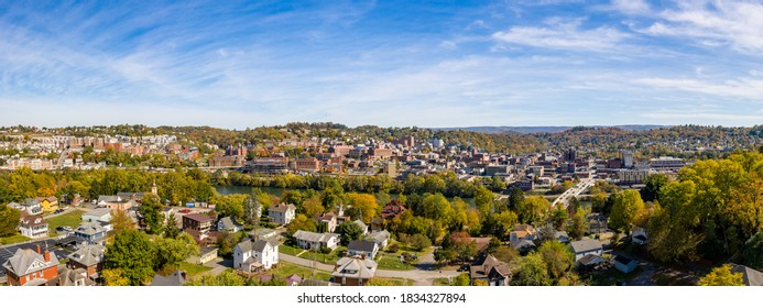 Morgantown, WV - 14 October 2020: Aerial drone panoramic shot of the downtown area of Morgantown with the WVU campus in the fall