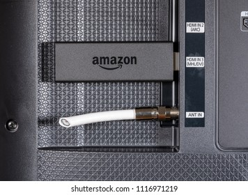 MORGANTOWN, WV - 20 JUNE 2018: Amazon Fire TV streaming stick alongside cut cable connection