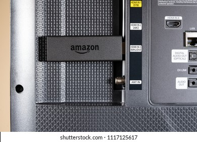 MORGANTOWN, WV - 20 JUNE 2018: Amazon Fire TV streaming stick inserted in HDMI socket on SmartTV
