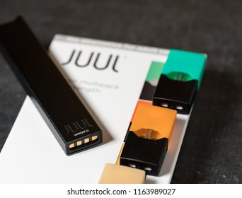 MORGANTOWN, WV - 24 AUGUST 2018: Juul e-cigarette or nicotine vapor dispenser box on slate
