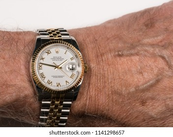 MORGANTOWN, WV - 24 JULY 2018: Rolex Oyster Perpetual Datejust gold watch on senior man's wrist