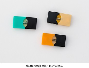 MORGANTOWN, WV - 25 AUGUST 2018: Juul e-cigarette or nicotine vapor containers known as JUULpods on white background