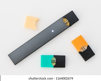MORGANTOWN, WV - 25 AUGUST 2018: Juul e-cigarette or nicotine vapor stick and JUULpods on white background