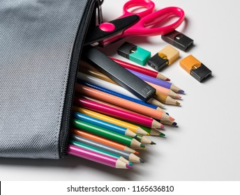 MORGANTOWN, WV - 26 AUGUST 2018: Juul e-cigarette or nicotine vapor stick and JUULpods in pencil case