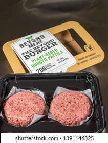 MORGANTOWN, WV - 6 MAY 2019: Packagingand contents of Beyond Meat Beyond Burgers on steel background