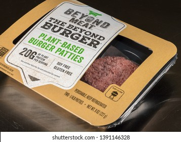 MORGANTOWN, WV - 6 MAY 2019: Packaging for Beyond Meat Beyond Burgers on steel background