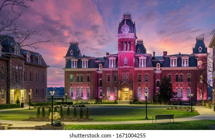 Morgantown, WV - 8 March: Dramatic image of Woodburn Hall at West Virginia University or WVU in Morgantown WV as the sun sets behind the illuminated historic building
