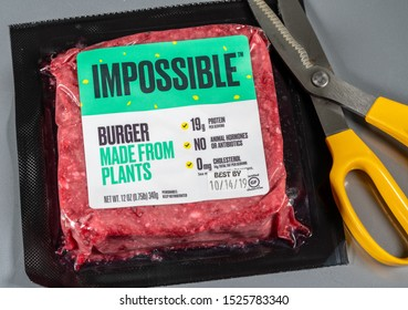 MORGANTOWN, WV - 8 October 2019: Packaging for Impossible Foods burger made from plants on steel background