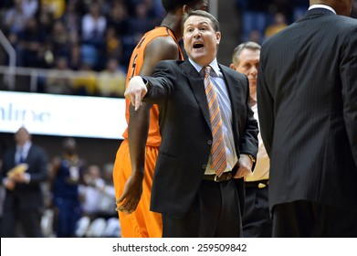 MORGANTOWN, WV - MARCH 7: Oklahoma State Cowboys head coach Travis Ford yells at an official (unseen) during the Big 12 Conference college basketball game March 7, 2015 in Morgantown, WV.
