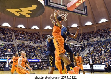 MORGANTOWN, WV - MARCH 7: WVU forward Jonathan Holton (1) scores on an offensive rebound defends during the Big 12 Conference college basketball game March 7, 2015 in Morgantown, WV.