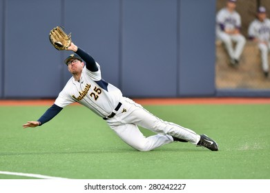 MORGANTOWN, WV - MAY 1: West Virginia outfielder Brad Johnson (25) makes a diving catch during a Big 12 conference baseball game May 1, 2015 in Morgantown, WV.