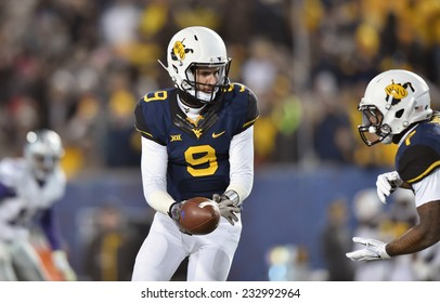 MORGANTOWN, WV - NOVEMBER 20: West Virginia Mountaineers quarterback Clint Trickett (9) turns to hand the ball off during the Big 12 football game November 20, 2014 in Morgantown, WV.