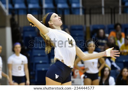 MORGANTOWN, WV - NOVEMBER 22: West Virginia middle blocker Evyn McCoy (14) serves in the Big 12 volleyball match against Baylor November 22, 2014 in Morgantown, WV.