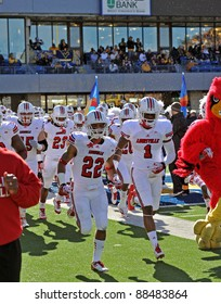 MORGANTOWN, WV - NOVEMBER 5: The Louisville Cardinals football team takes the field prior to the football game between WVU and Louisville November 5, 2011 in Morgantown, WV