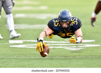 MORGANTOWN, WV - NOVEMBER 7: West Virginia Mountaineers linebacker Nick Kwiatkoski (35) leaps to cover a loose ball during the football game November 7, 2015 in Morgantown, WV.