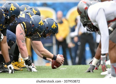 MORGANTOWN, WV - NOVEMBER 7: The WVU offensive line lines up over the ball during the football game November 7, 2015 in Morgantown, WV.