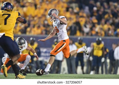 MORGANTOWN, WV - OCTOBER 10:  Oklahoma State Cowboys kicker Ben Grogan (19) has to abort a kick when the holder fumbles the ball during the Big 12 football game October 10, 2015 in Morgantown, WV.