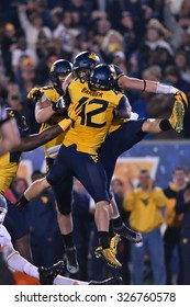 MORGANTOWN, WV - OCTOBER 10: West Virginia Mountaineers linebacker Jared Barber (42) celebrates a big defensive stand during the Big 12 football game October 10, 2015 in Morgantown, WV.