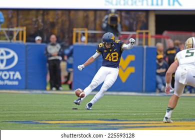 MORGANTOWN, WV - OCTOBER 18: West Virginia Mountaineers place kicker Michael Molinari (48) kicks off following a Mountaineer score during the Big 12 football game October 18, 2014 in Morgantown, WV.