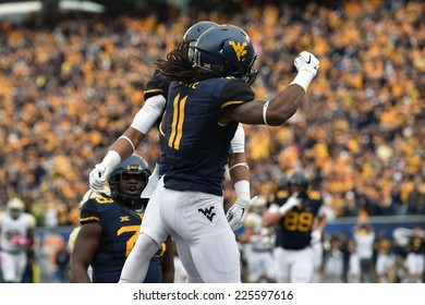 MORGANTOWN, WV - OCTOBER 18: West Virginia Mountaineers wide receiver Kevin White (11) celebrates a touchdown with a teammate during the Big 12 football game October 18, 2014 in Morgantown, WV.