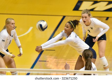 MORGANTOWN, WV - SEPTEMBER 25: West Virginia outside hitter Morgan Montgomery (3) digs a serve during a volleyball match  September 25, 2015 in Morgantown, WV.