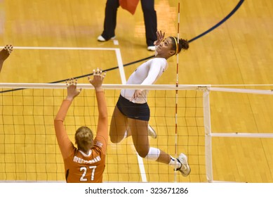 MORGANTOWN, WV - SEPTEMBER 25: West Virginia outside hitter Morgan Montgomery (3) goes up for a spike during a volleyball match  September 25, 2015 in Morgantown, WV.