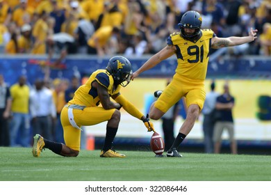 MORGANTOWN, WV - SEPTEMBER 26: West Virginia Mountaineers punter Nick O'Toole (91) boots the opening kickoff during the NCAA football game September 26, 2015 in Morgantown, WV.