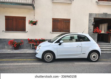 MORGEX, ITALY - JUNE 22: New Fiat 500 in the street of Morgex, Italy on June 22, 2015. Fiat 500 is a mini car by Italian automaker Fiat since 2007.