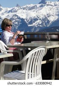 MORGINS, SWITZERLAND - MAR 1 - Skiers relax at a high mountain restaurant  on Mar 1, 2012 near Morgins, Switzerland.