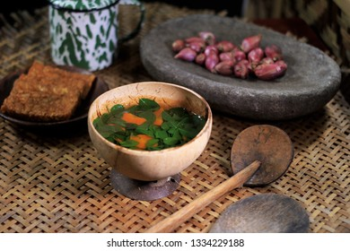 Moringa leaf Soup with Carot on the Coconut bowl and Fried Soy bean cake