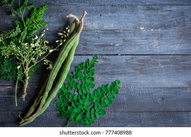 Moringa oleifera, Moringa leaves, Moringa flower, Moringa seed on wood background