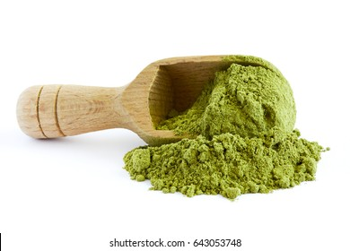 Moringa oleifera powder with wooden scoop isolated on white background