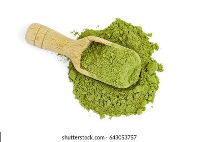 Moringa oleifera powder with wooden scoop isolated on white background. Top view