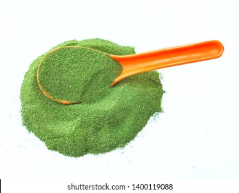 Moringa powder image, a heap and a spoon of dried healthy moringa leaves powder. Moringa leaves and its  powder are very good nutritious and superfood, and a herbal ingredient