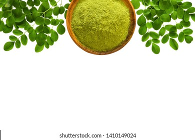 Moringa powder (Moringa Oleifera) in wooden bowl with original fresh Moringa leaves isolated on white background. Top view with copyspace. Healthy product, superfood, vitamin.