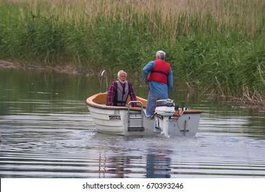 MORKO SWEDEN 17 JUNE 2017.. Two adult men in a smaller motor boat.