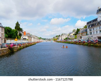 Morlaix, France - August 10 2018: Down the Dossen River towards the marina, houses and cars line both banks of the river.