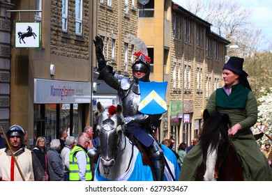 Morley Leeds UK 23 April 2017 Saint Georges day parade re-enactment of St George on horseback wearing armour riding through the streets of morley - Editorial
