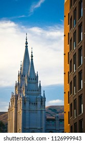 A Mormon temple and a an office building with mountains in the background. Sunny summer afternoon in the Mid-West, USA.
