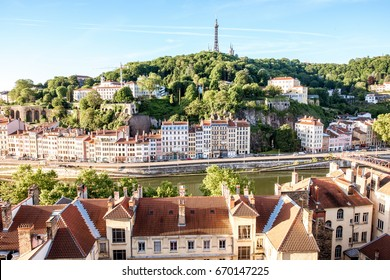 Morning aerial cityscape view with beautiful old buildings and metallic tower on the mountain in Lyon city in France