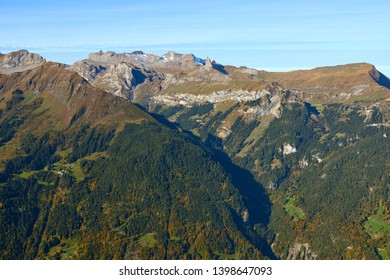 Morning aerial view of the mountains panorama with atumn forest on the mountainsides in Lauterbrunnen valley in Switzerland.