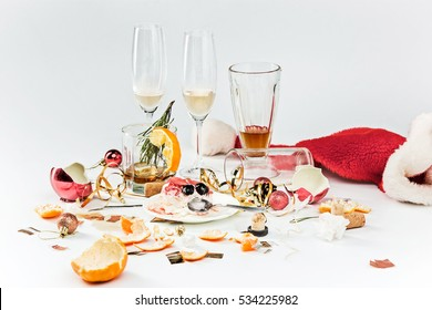 The morning after christmas day, table with alcohol and leftovers from a celebratory feast on gray