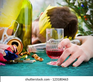 morning after christmas day, woman asleep on table with alcohol at christmas landscape