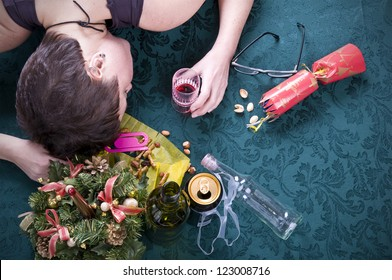 morning after christmas party, woman asleep on table with alcohol at christmas